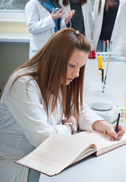 Nurse studying pathology