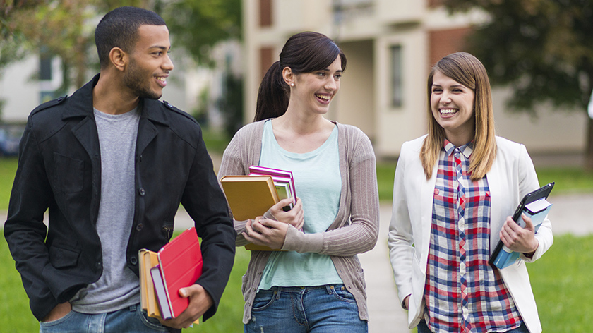 Three nontraditional students walking to parking lot after class.
